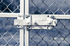 Old lock on metal fence Royalty Free Stock Photography