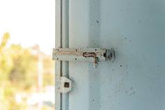 Old lock on the metal window. Royalty Free Stock Photography