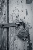 Old lock. Old open padlock with key on a chain Royalty Free Stock Photo
