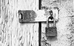 Old lock in peeling painted wood door Royalty Free Stock Photography