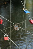 Old lock on rope bridge Stock Images