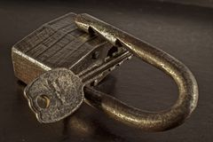 Old lock. Old rusty lock with key, suitable for operation Stock Photo