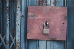 Old lock and Rusty padlock on an old steel door with vintage sty Stock Photo