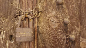 Old Lock. Old rusty vintage lock on a wooden door Royalty Free Stock Photography