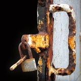 Old lock. Weighing on rusty door Stock Photo