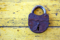 Old lock on wooden boards Stock Photos