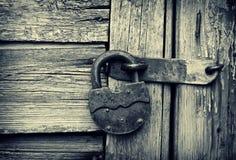 Old lock on a wooden door Stock Photos