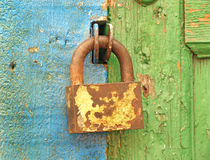 Old lock on a wooden door. Royalty Free Stock Images