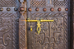 Old lock on a wooden door Royalty Free Stock Images