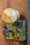 Old lock and wooden door knob. Close up of an old lock and wooden door knob Stock Image