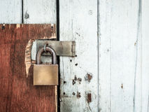 Old lock on a wooden door Royalty Free Stock Image