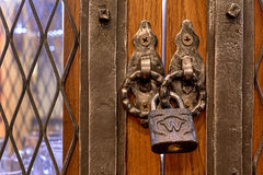 The old lock on a wooden door for print Stock Photos