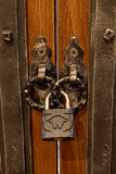 The old lock on a wooden door for print Royalty Free Stock Image