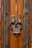 The old lock on a wooden door for print Royalty Free Stock Photography