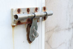 Old lock on wooden door Stock Photos