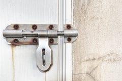 Old lock on wooden door Stock Image