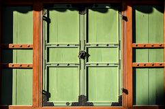 The old lock on The wooden green door. Royalty Free Stock Photos