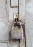 Old lock on wooden grungy painted door Royalty Free Stock Images