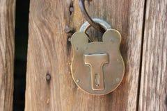 Old locked antique padlock macro. Background royalty free stock photo