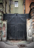 Old locked black metal square gate Stock Image
