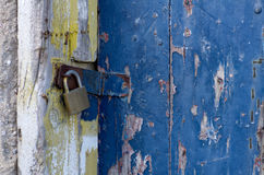 Old Locked Door. Close up view of an old weathered locked door Royalty Free Stock Image