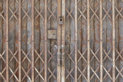 Old Locked Foldable Rusted Steel Door stock photography