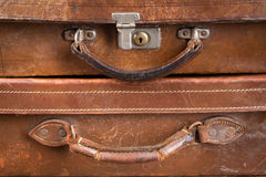 Old locked suitcases. Detail of two very old brown leather locked suitcases Royalty Free Stock Photography