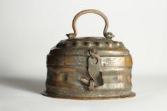 Old locked tin box stock image