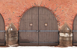 Old locked wooden gate in red brick fortress wal Stock Photo