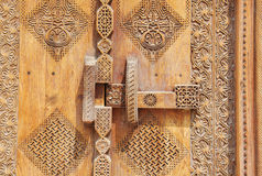 Old Locking system in beautifully carved door Royalty Free Stock Photos