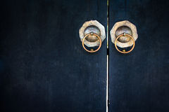 Old lockpad locked on a wooden blue door. With rusty chain close up background Royalty Free Stock Photography