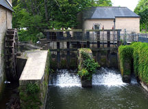 Old locks in Bayeux on the river Aure, Normandy. Stock Images