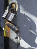 Old locks with keys on garage door. Old locks with keys on the garage door stock image