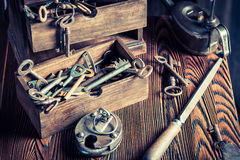 Old locksmiths workshop with tools, locks and keys Royalty Free Stock Photos