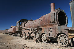 Old locomotive. Old steam locomotive growing rusty in a desert Stock Images