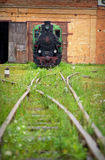 Old locomotive. In front of depot royalty free stock photo