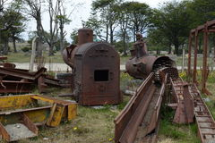 Old locomotive boilers on the southernmost railway in the world. USHUAIA, ARGENTINA - NOVEMBER 17,2014:Old locomotive boilers on the southernmost railway in the Stock Images