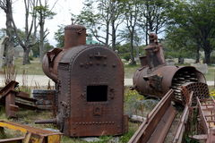 Old locomotive boilers on the southernmost railway in the world. Royalty Free Stock Photography