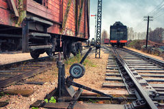 Old locomotive and cars on a railway station Stock Image