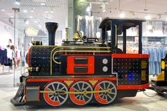 An old locomotive for children riding in the shopping center stock photo