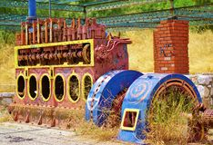 Old Locomotive Engine. An old painted and rusty locomotive internal combustion engine Stock Photo