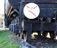 Old locomotive with interesting graffiti. Old rusty locomotive parked on railway station Knin, Croatia. One section painted with graffiti Royalty Free Stock Images