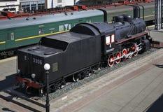 Old locomotive on the railway station in Vladivostok. Russia Stock Photography