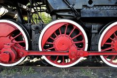Old locomotive red wheels. Old steam locomotive red wheels Stock Images