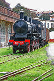 An old locomotive. An old steam train stopped at the station Royalty Free Stock Photos
