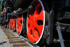 Old locomotive wheels Stock Images