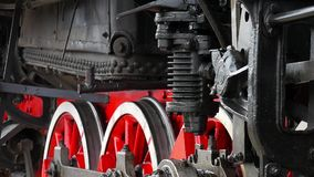 Old locomotive wheels close up. Detail of steam locomotive, side profile view, wheels, rods. Old locomotive wheels close up. Detail of steam locomotive, side stock video footage
