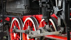 Old locomotive wheels close up. Detail of steam locomotive, side profile view, wheels, rods. Old locomotive wheels close up. Detail of steam locomotive, side stock footage
