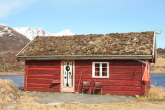 Old  Lofoten's rorbu with grass on the roof Stock Images