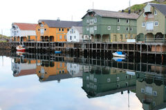Old lofts mirroring at the midnight sun in Nyksund Stock Image